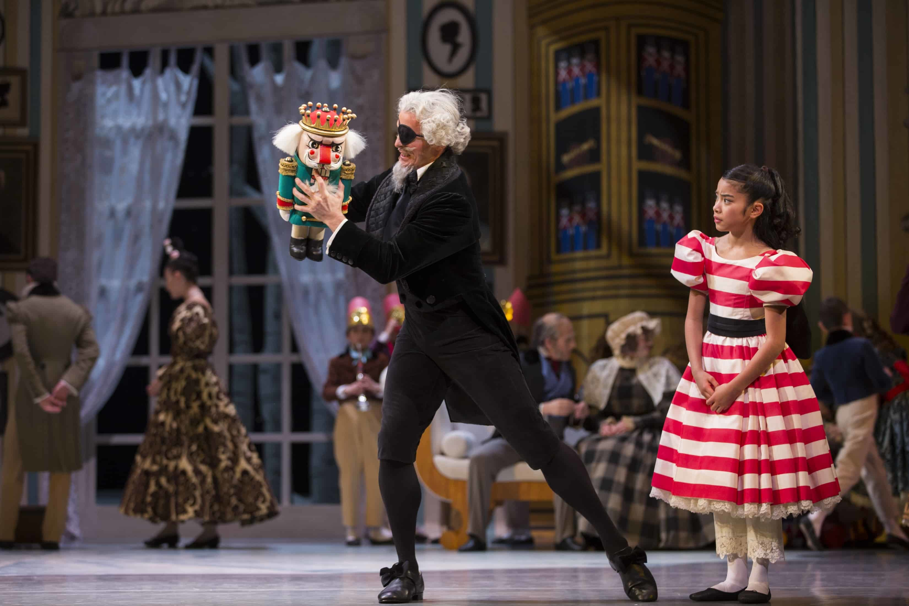 Clara, Drosselmeier, and Nutcracker doll. George Balanchine's The Nutcracker®, choreography by George Balanchine © The George Balanchine Trust. Photo © Angela Sterling.