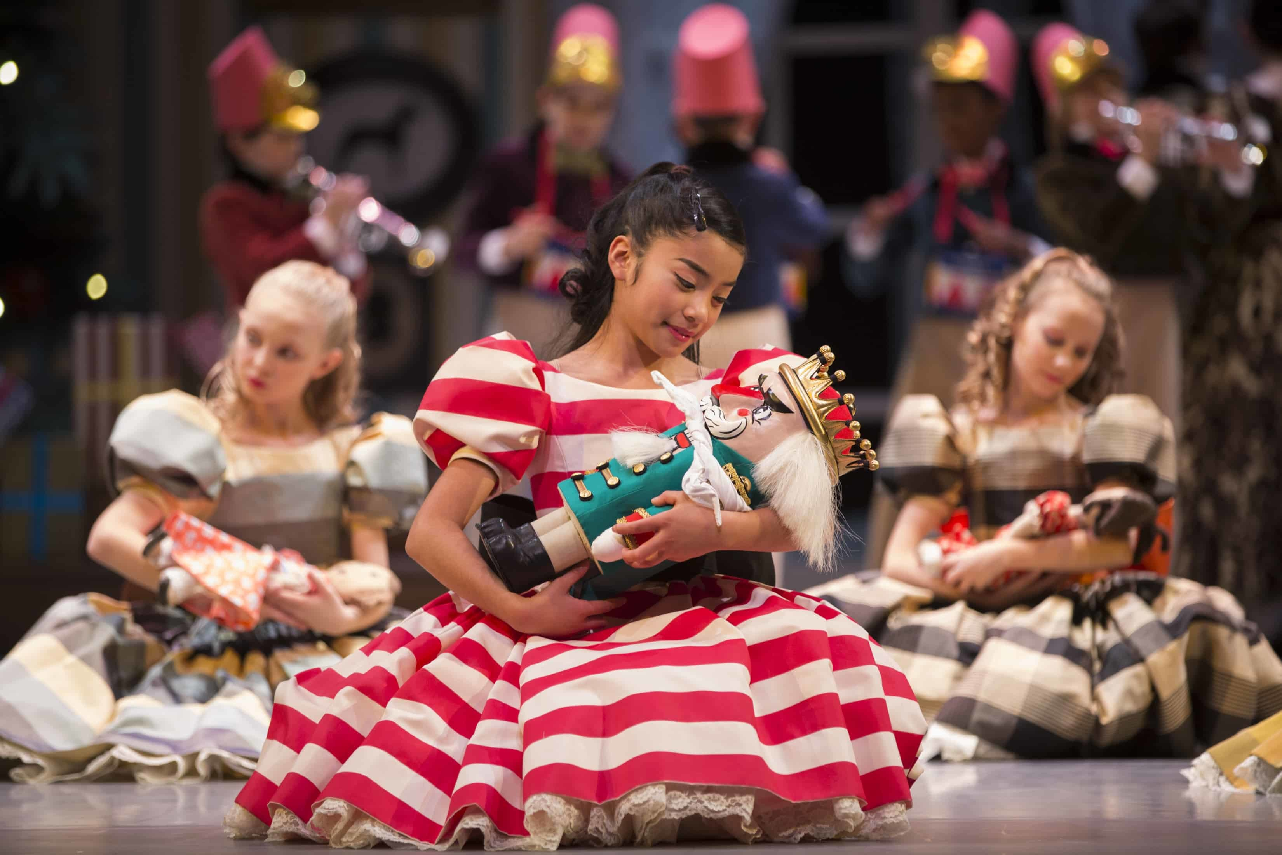 Clara with her Nutcracker doll. George Balanchine's The Nutcracker®, choreography by George Balanchine © The George Balanchine Trust. Photo © Angela Sterling.